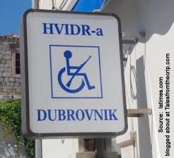 handicap symbol holding rifle.