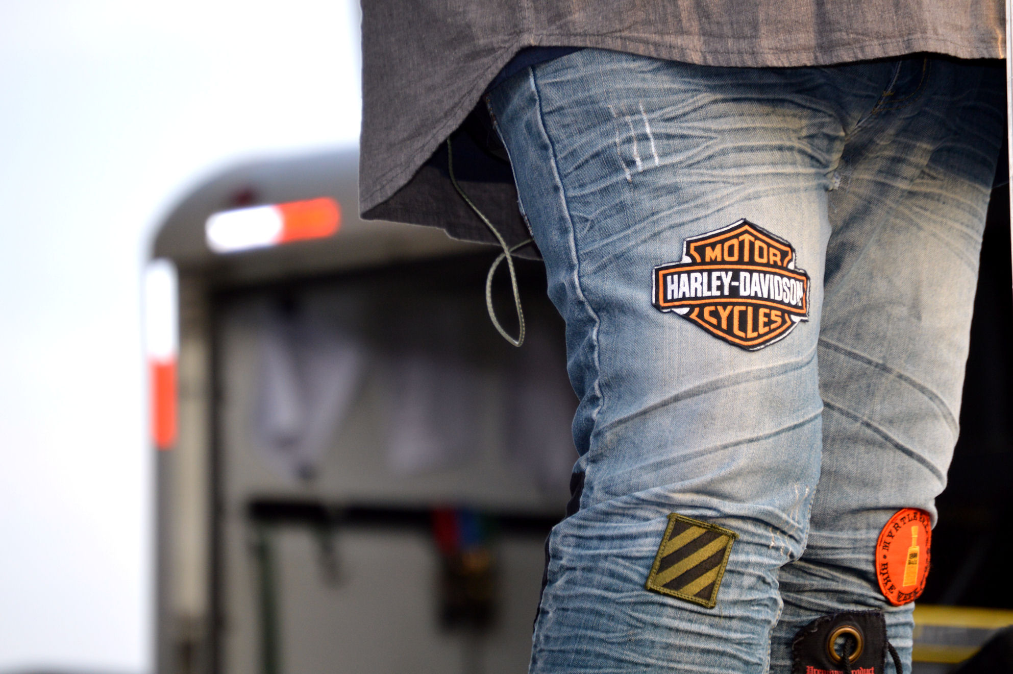 blue jeans, old, worn with harley davidson and other patches